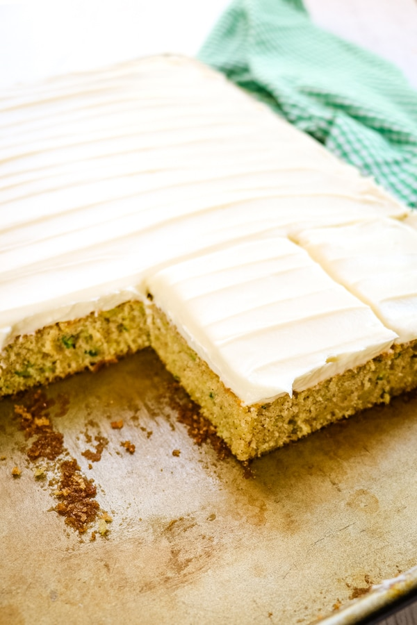 sliced zucchini sheet cake, sliced into squares