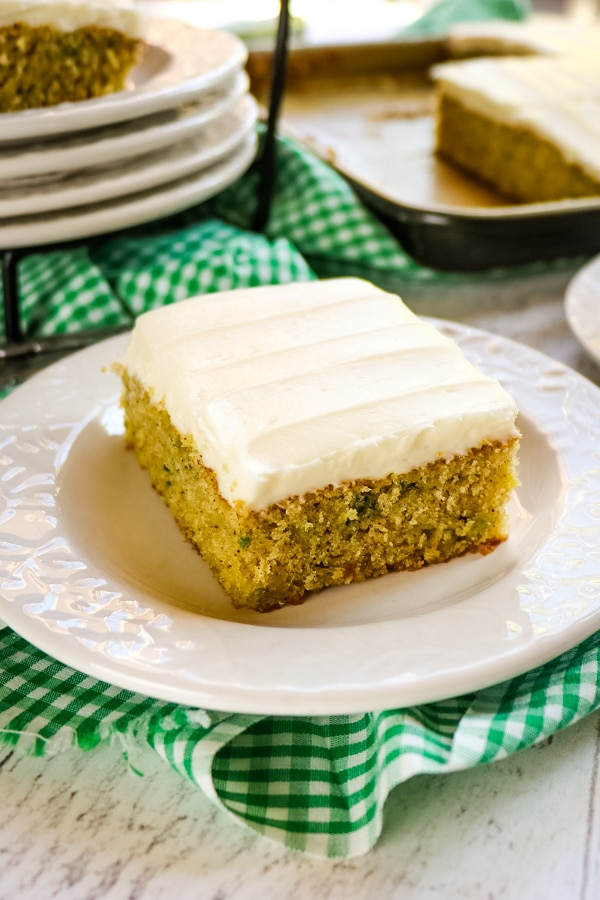 square slice of zucchini cake on white plate