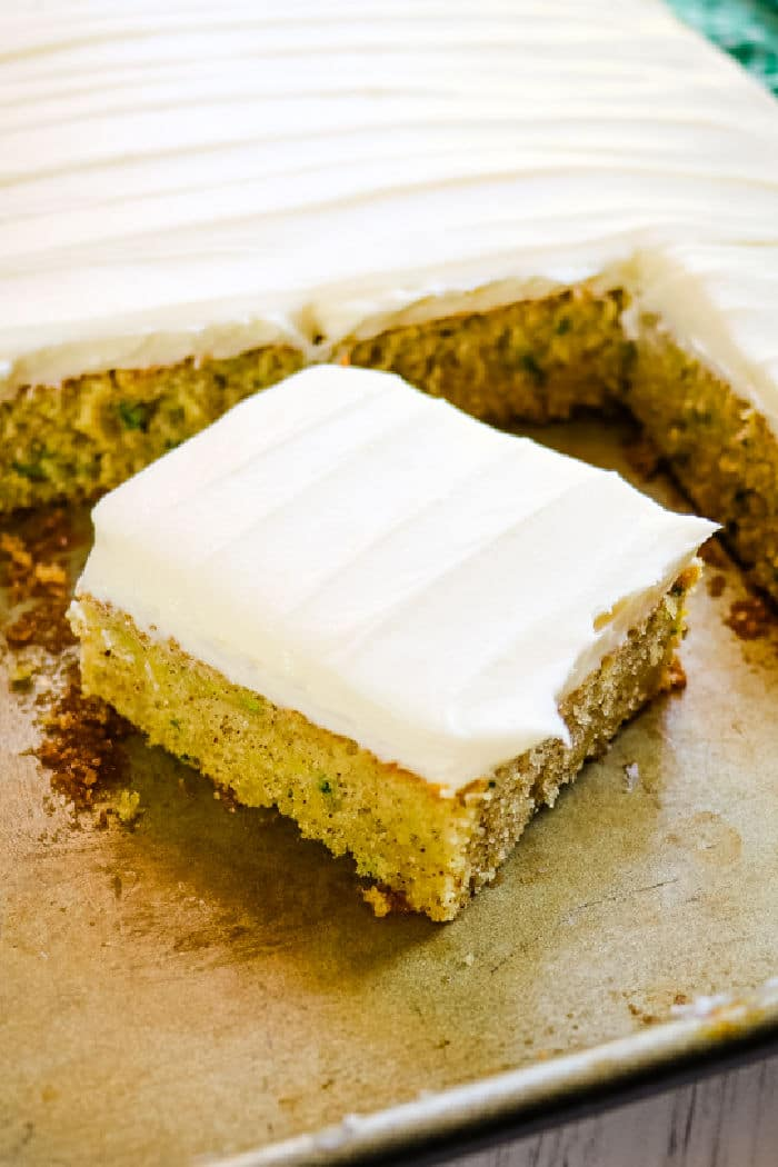 zucchini cake with cream cheese frosting, square slice of cake.