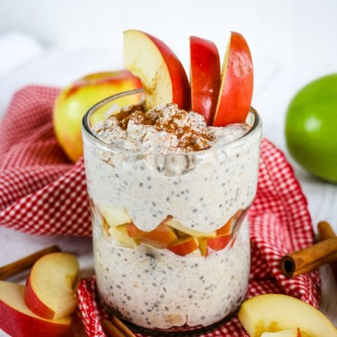 Apple cinnamon overnight oats, topped with sliced apples and cinnamon