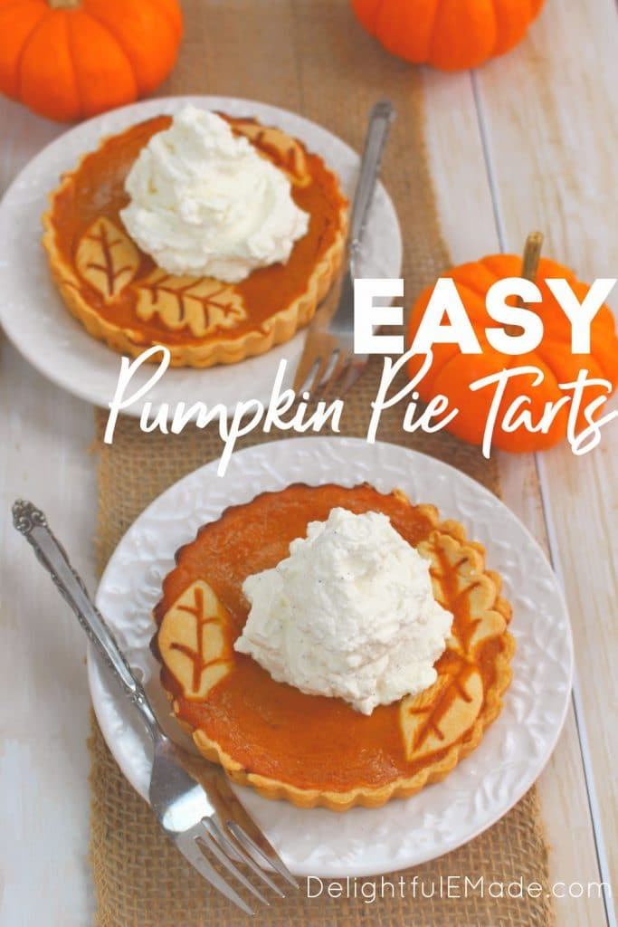 Pumpkin tarts on plate topped with whipped cream