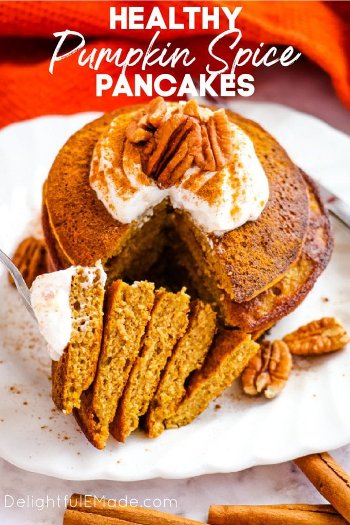 Healthy pumpkin pancakes topped with yogurt and pecans.