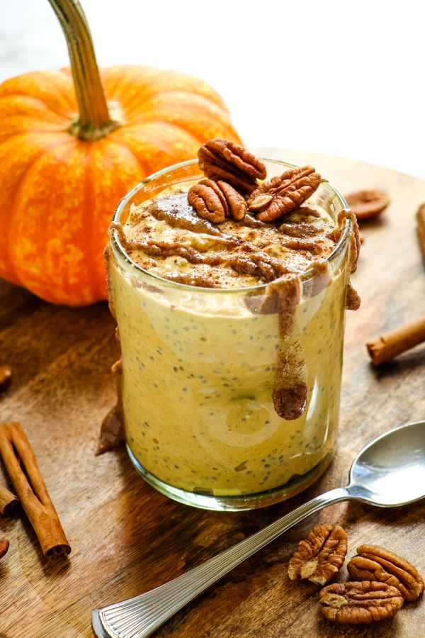 Pumpkin overnight oats topped with cinnamon, pecans and pecan butter.