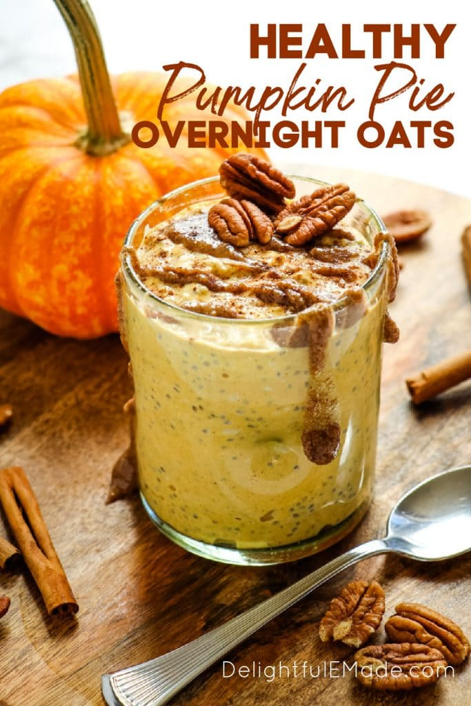 Pumpkin pie overnight oats in a glass, topped with pecans and pecan butter.