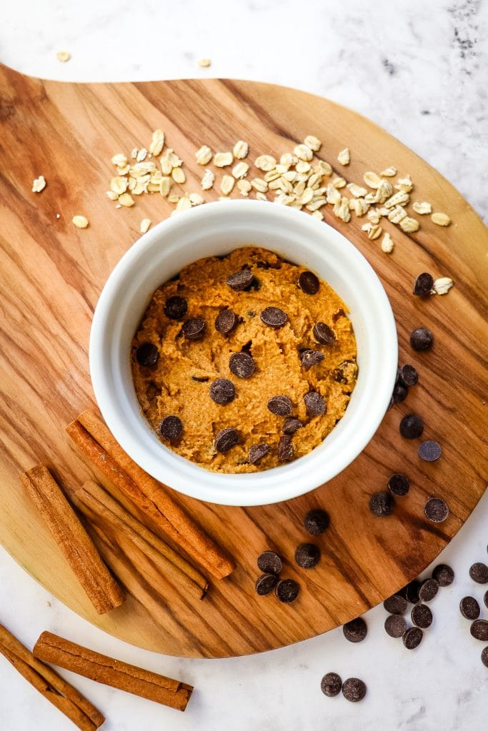 Pumpkin mug cake batter topped with chocolate chips.