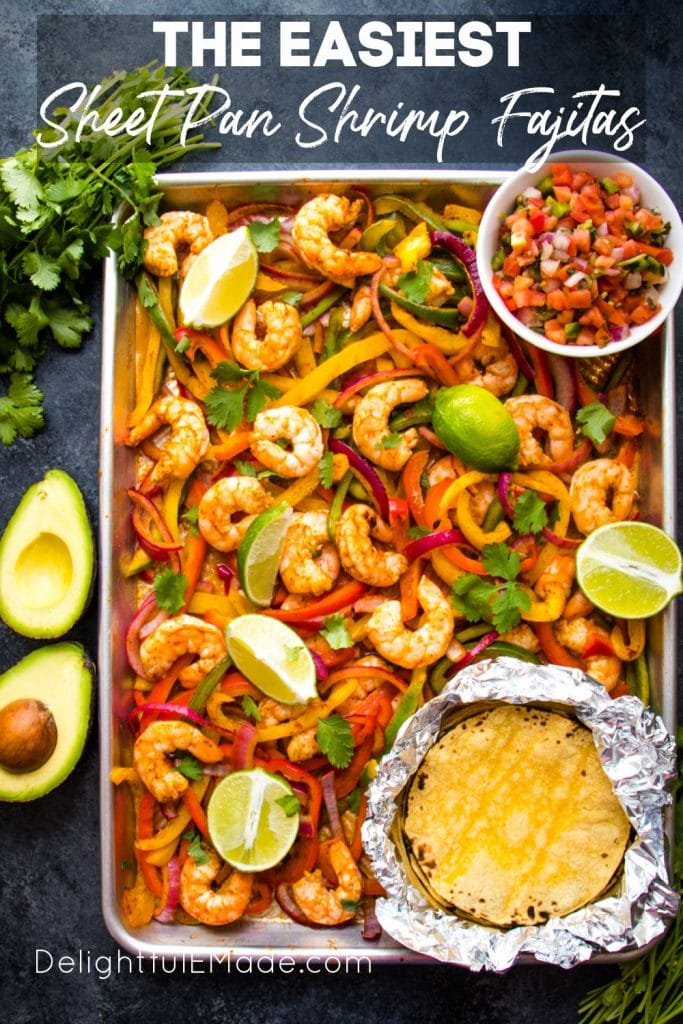 Sheet Pan Shrimp Fajitas with cilantro and lime wedges.