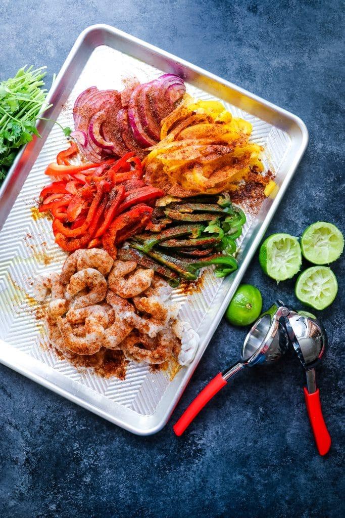 Ingredients sliced for sheet pan shrimp fajitas recipe.