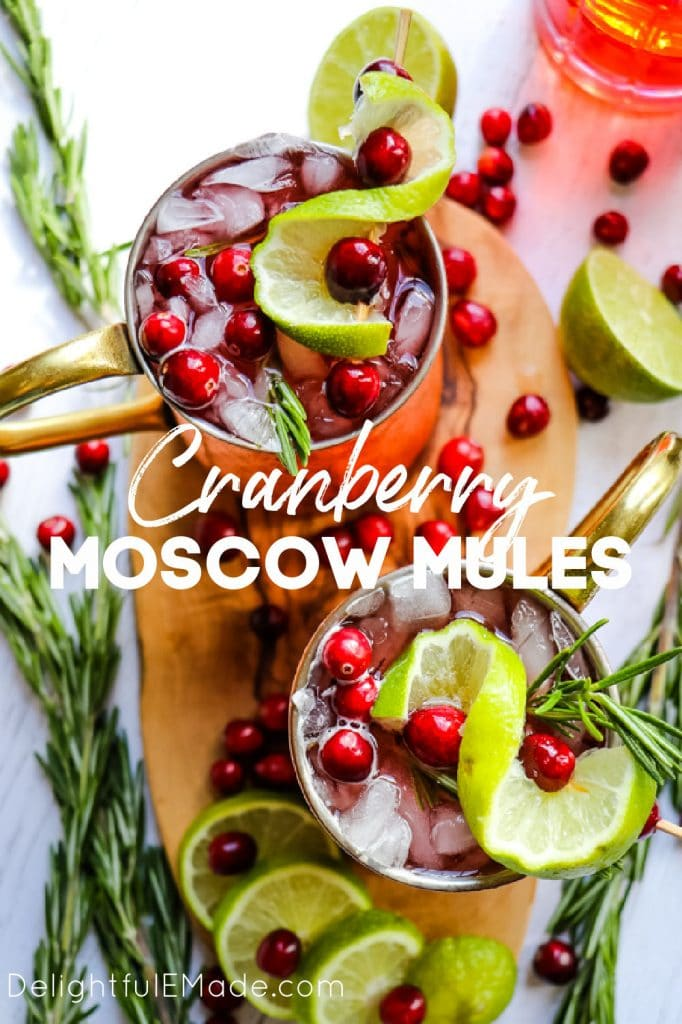 Cranberry Moscow mules in copper mugs, Christmas moscow mules with cranberries and limes.