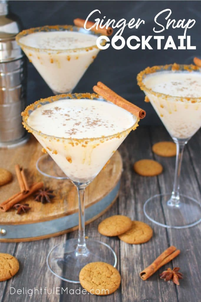 Three martini glasses with ginger snap cocktail, garnished with cinnamon sticks and ginger snap cookies.