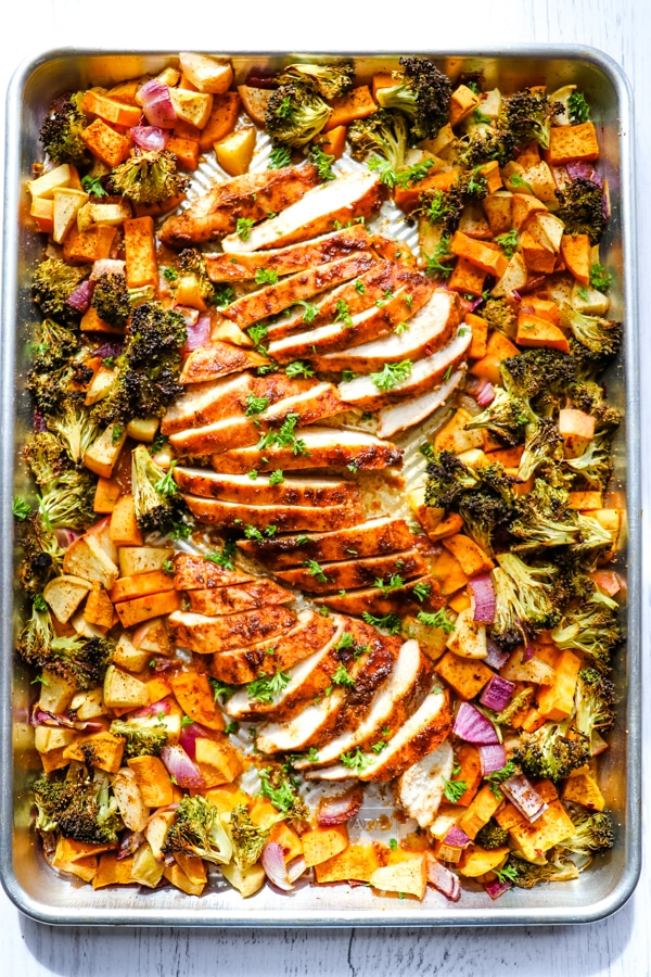 Baked sheet pan chicken and sweet potatoes, chicken sweet potato broccoli on sheet pan.