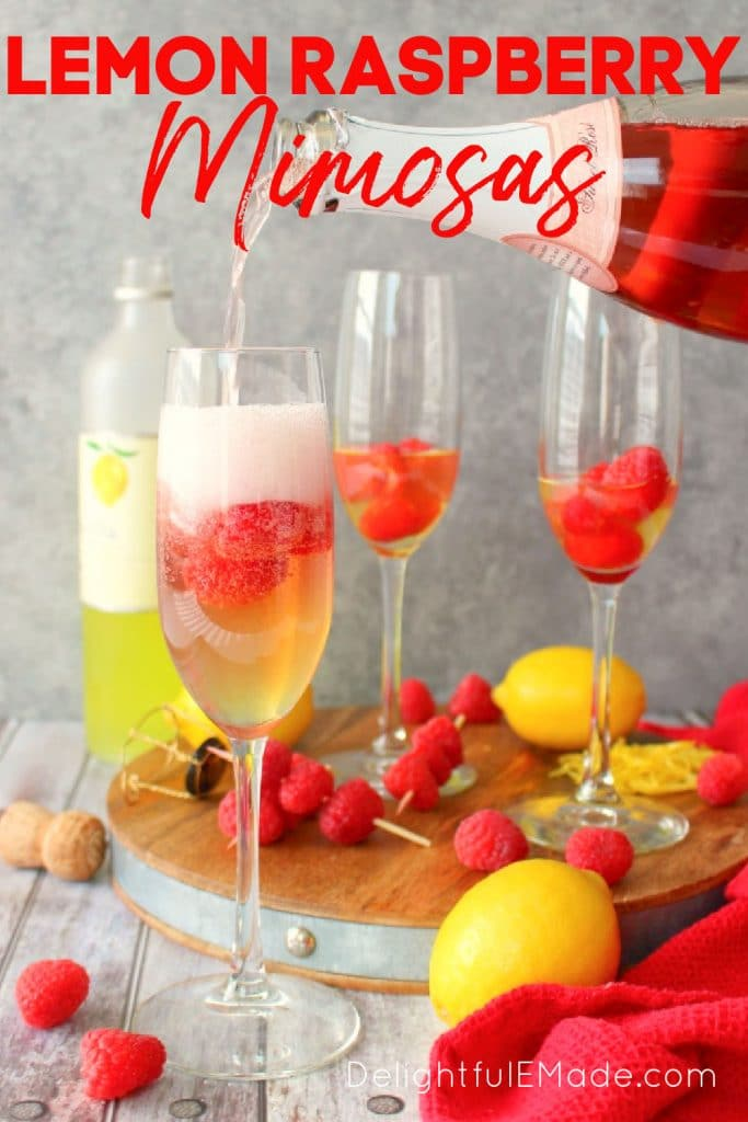 Lemon raspberry mimosa being topped off with rose champagne, raspberries in glasses.