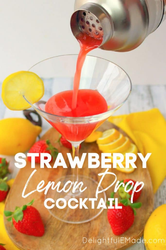 Strawberry lemon drop cocktail being poured into a martini glass.
