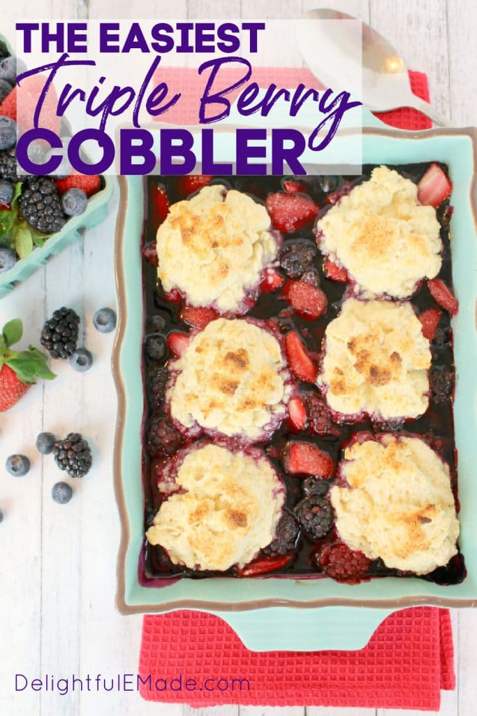 Triple Berry Cobbler recipe topped with biscuits and served with ice cream.
