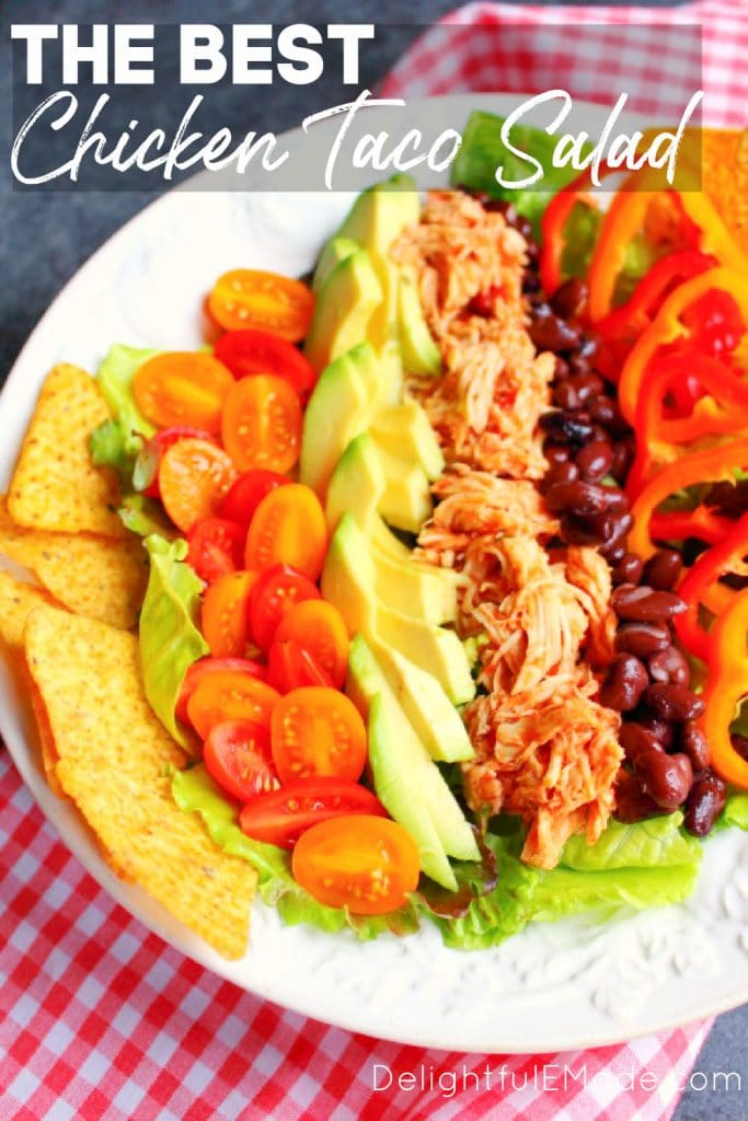 Chicken taco salad recipe in bowl with chips on the side.