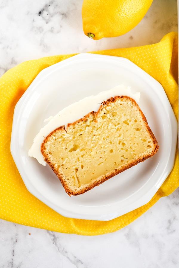 Copycat starbucks lemon loaf, slice on white plate