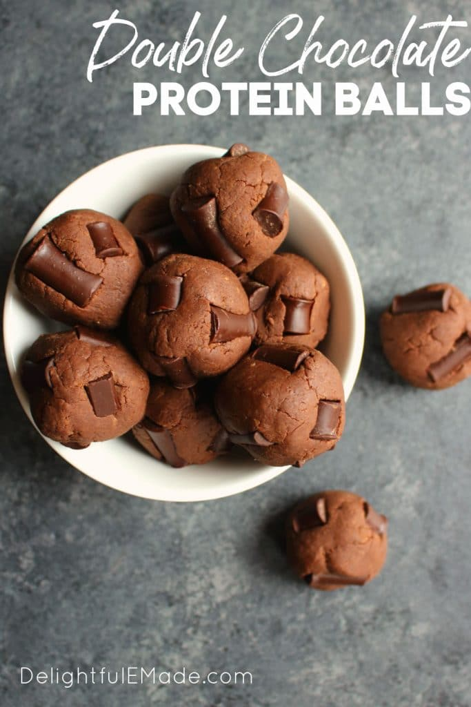 Double chocolate protein balls in a white dish.