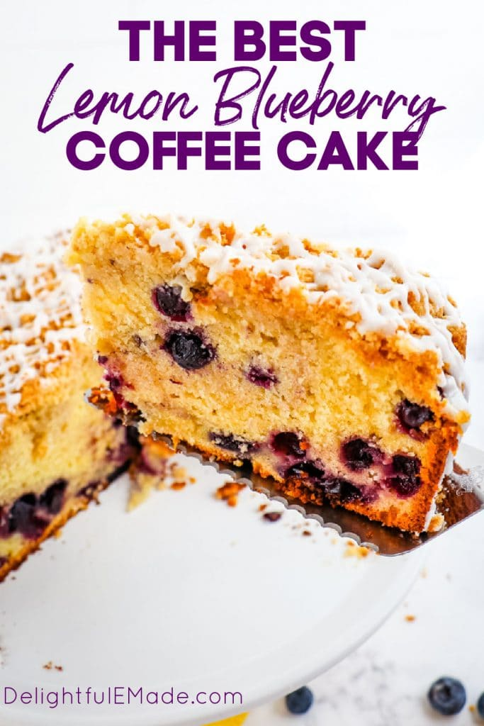 Lemon blueberry coffee cake with slice being lifted out of cake.