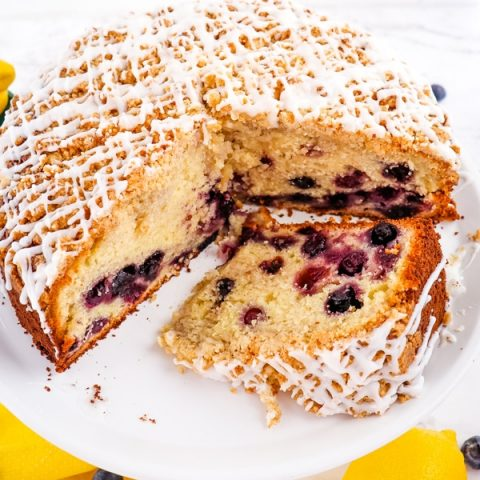 Lemon blueberry coffee cake, with slice on its side.