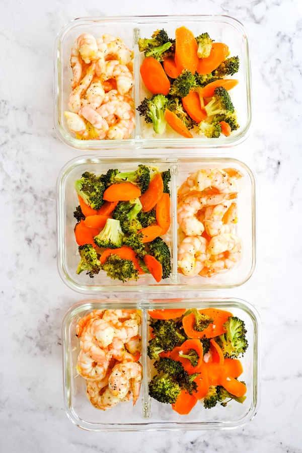Lemon pepper shrimp with vegetables in meal prep containers.