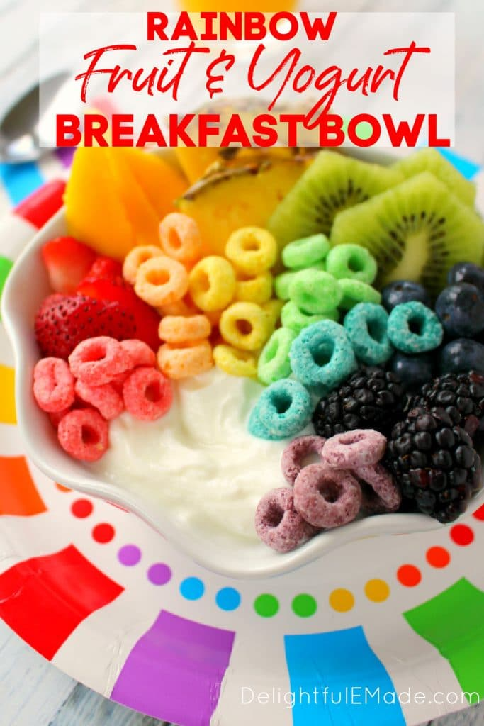 Rainbow fruit and yogurt breakfast bowl, topped with fruit loops.