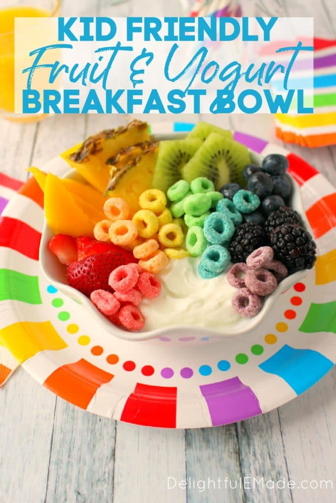 Rainbow fruit and yogurt breakfast bowl, topped with fruit loops., on rainbow colored plate.