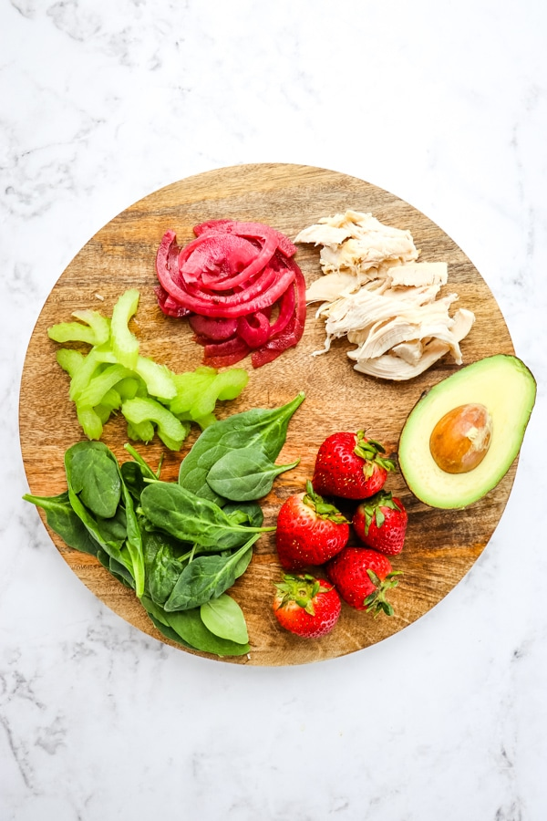 Ingredients for avocado strawberry salad with chicken.