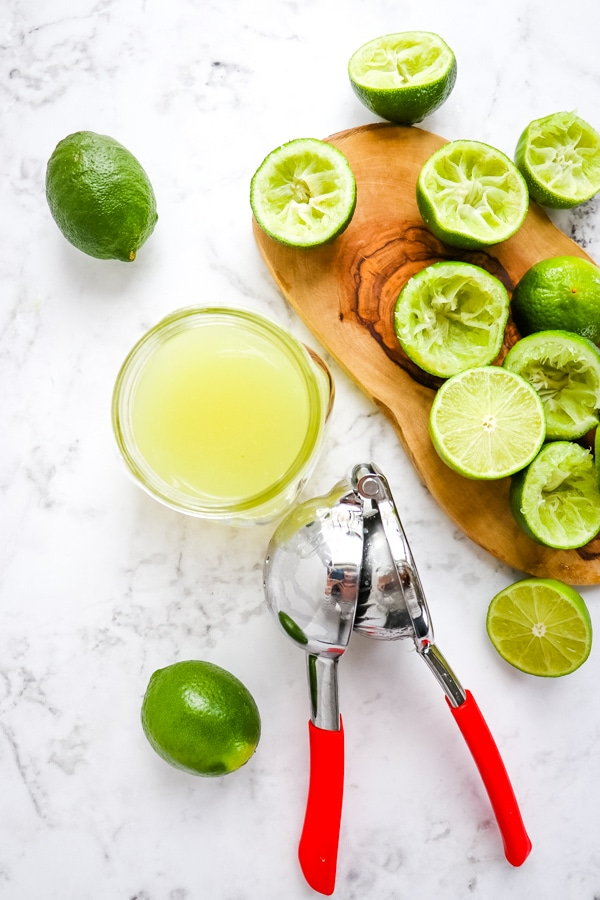 Limes and lime juice for coconut margarita recipe.