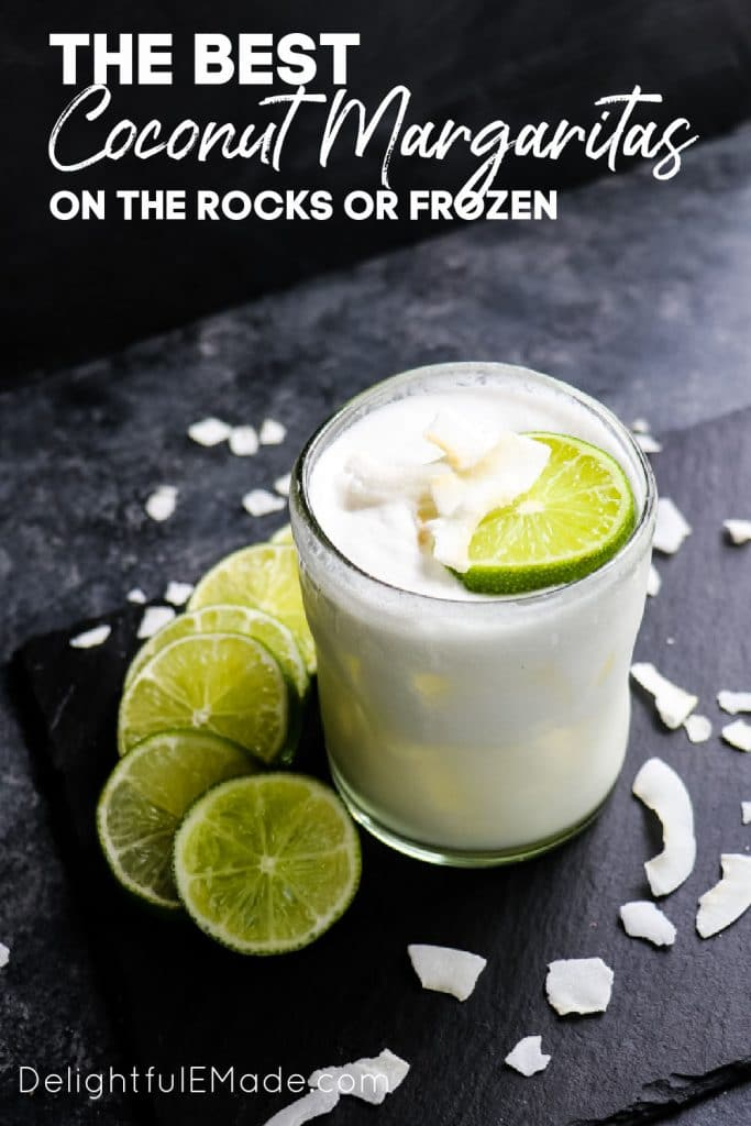 Coconut margarita on the rocks, with lime slices and coconut flakes.