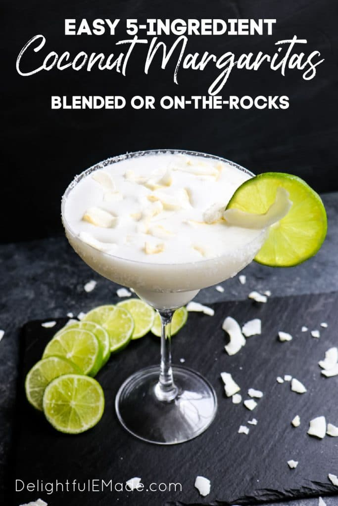 Coconut margarita with lime slices, topped with coconut.