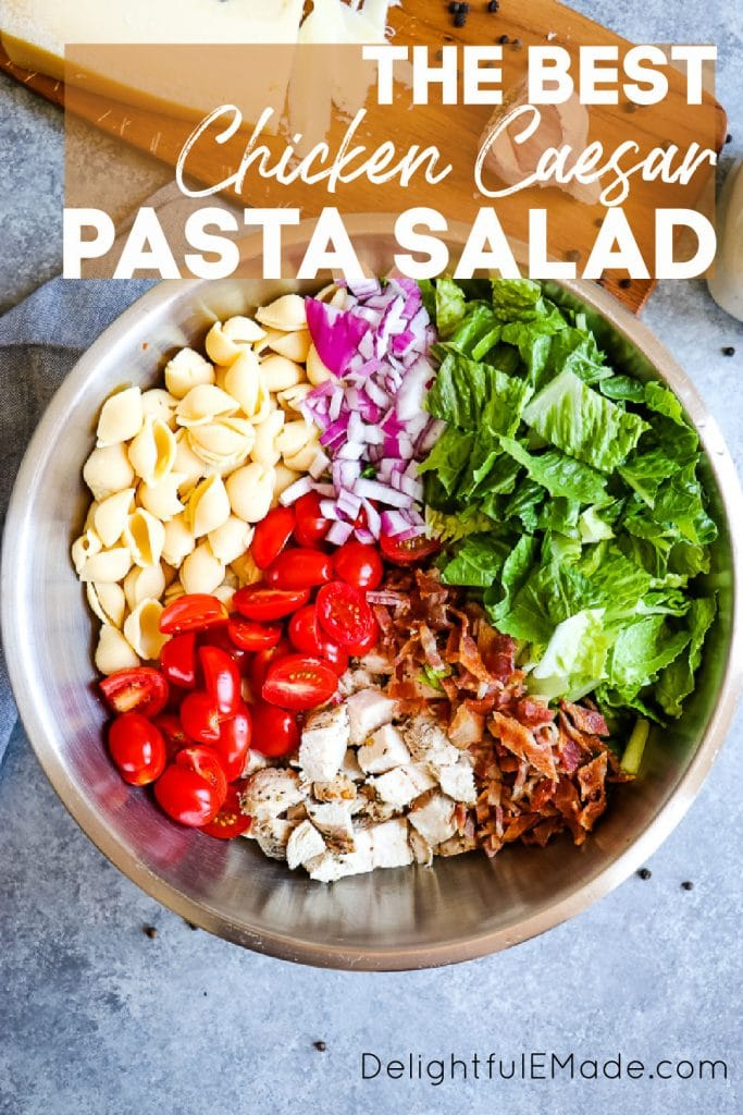 Healthy chicken caesar pasta salad in mixing bowl with ingredients separated.
