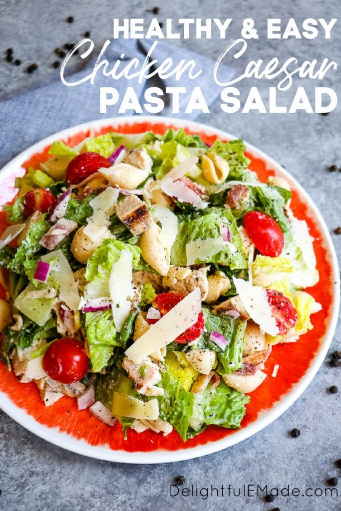 Chicken caesar pasta salad, on a plate with tomatoes.
