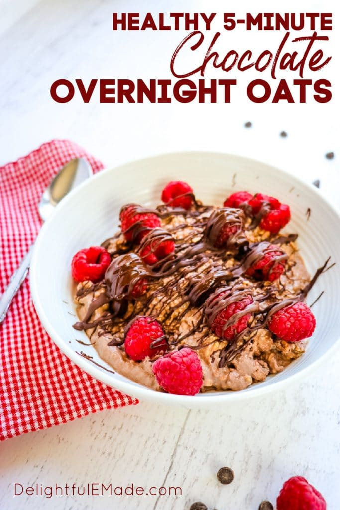 Chocolate overnight oats with raspberries and chocolate drizzle.