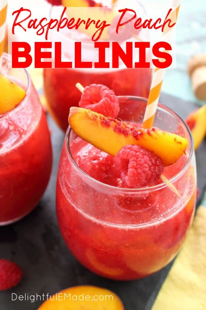 Frozen peach bellini recipe in a glass topped with fresh peach slices and raspberries.