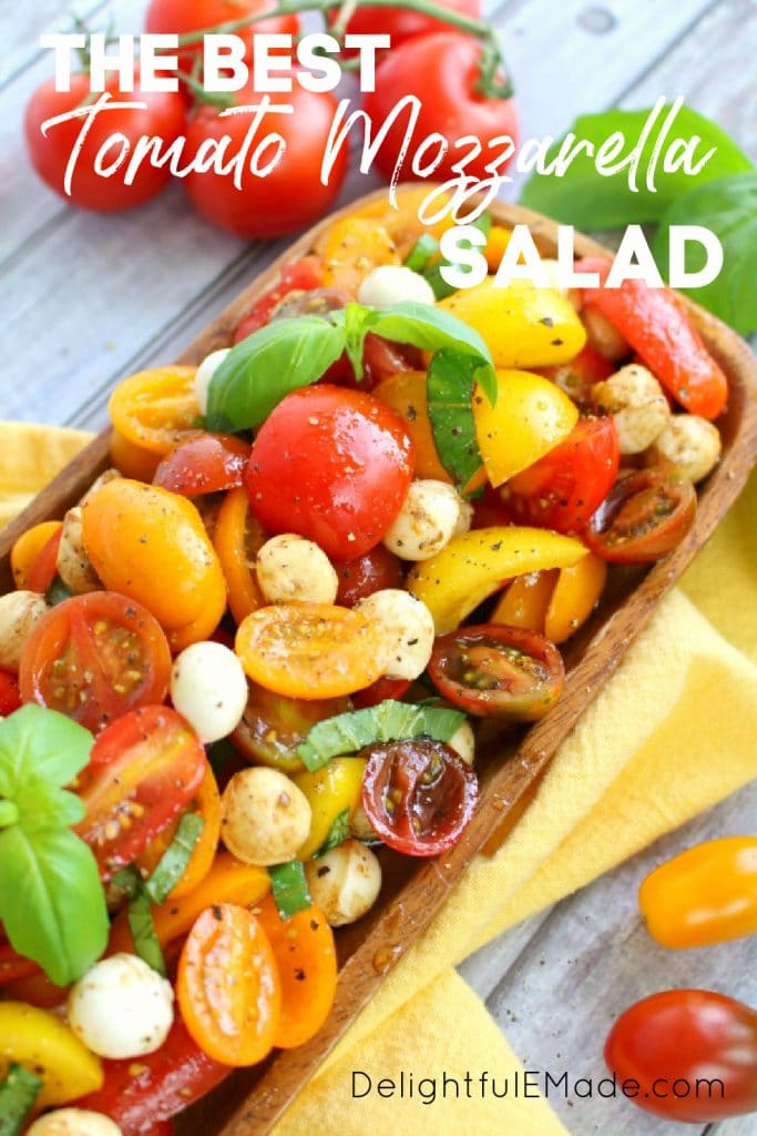 Caprese tomato salad with cherry tomatoes, italian tomato salad in bowl with basil leaves.