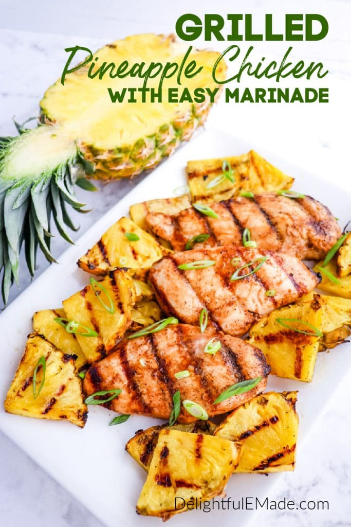 Platter with grilled pineapple chicken, grilled pineapple slices and garnished with halved pineapple.