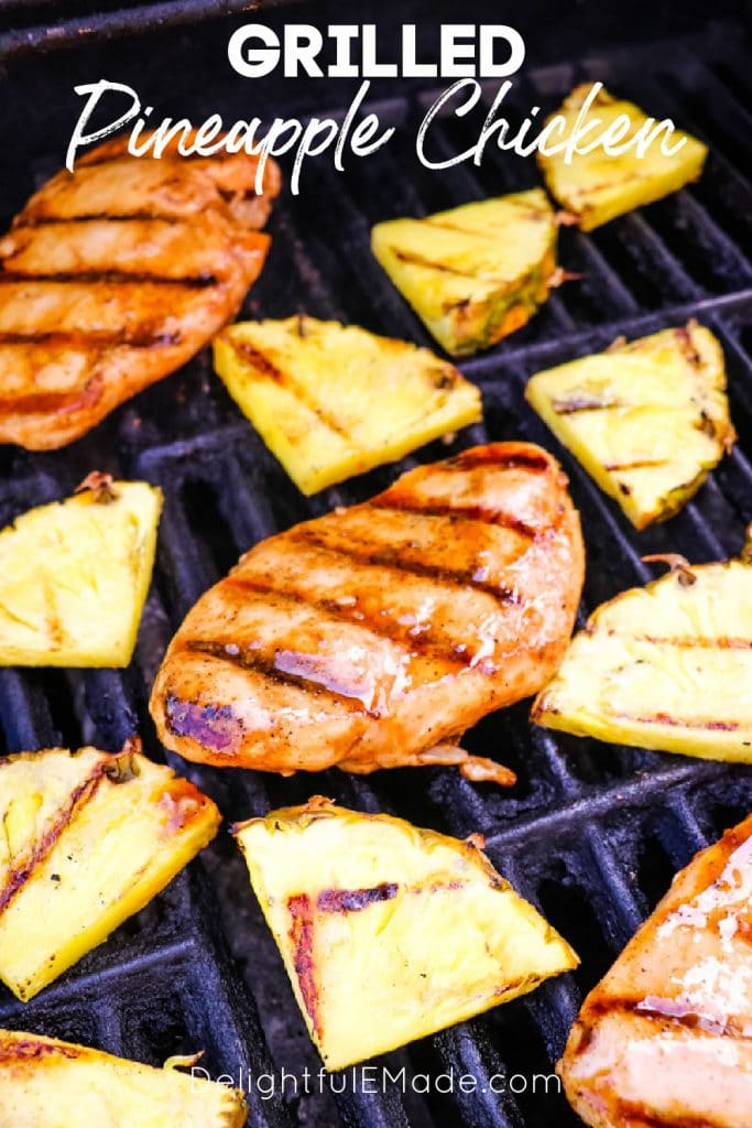 Grilled pineapple chicken with pineapple slices on grill.