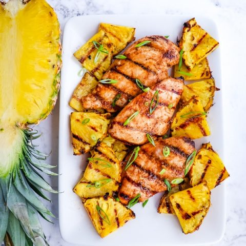 Platter with grilled pineapple chicken, chicken breasts and grilled pineapple slices.