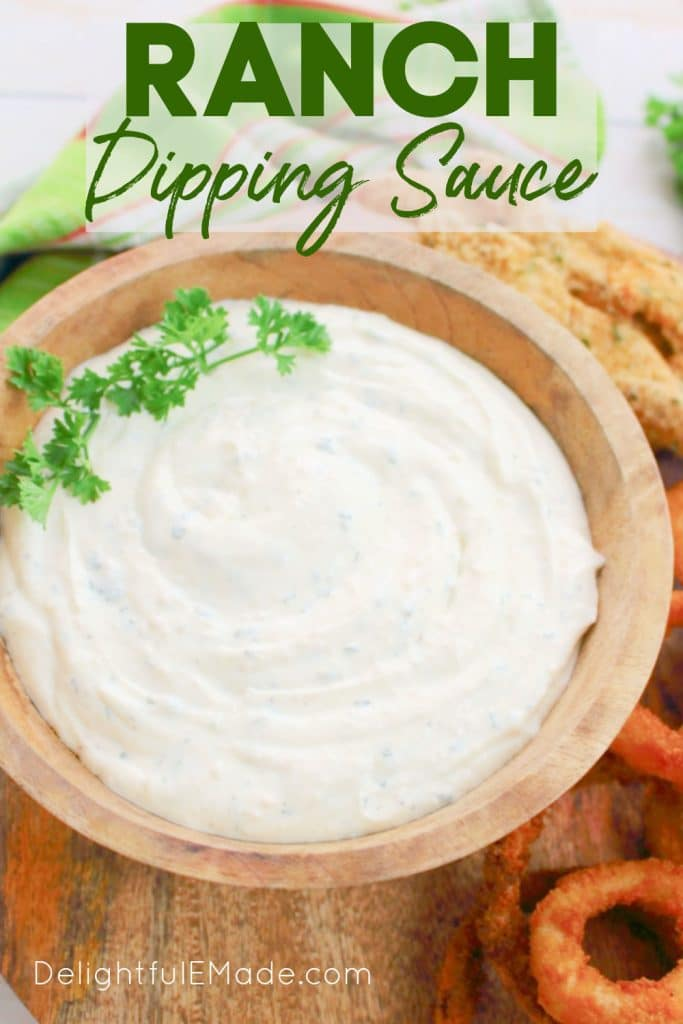 Ranch dipping sauce in a bowl, garnished with parsley.
