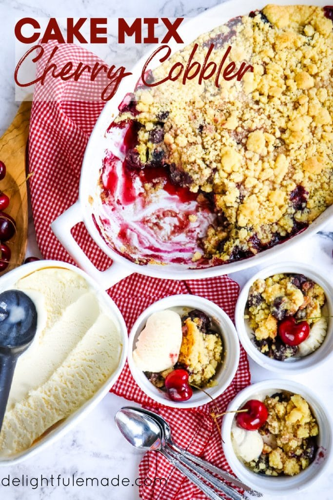 Cake mix cherry cobbler served into bowls with vanilla ice cream.