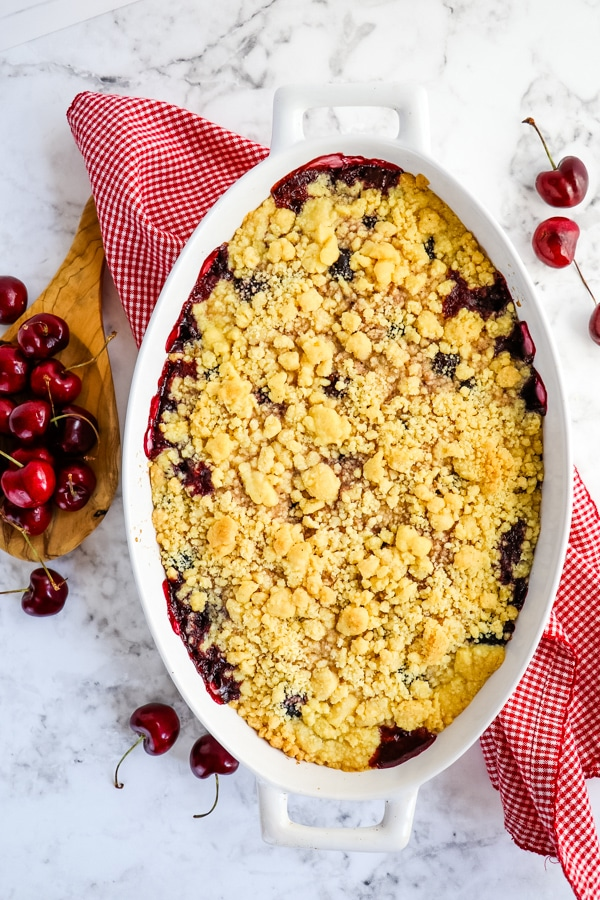 Cherry cobbler with cake mix, baked in baking dish.