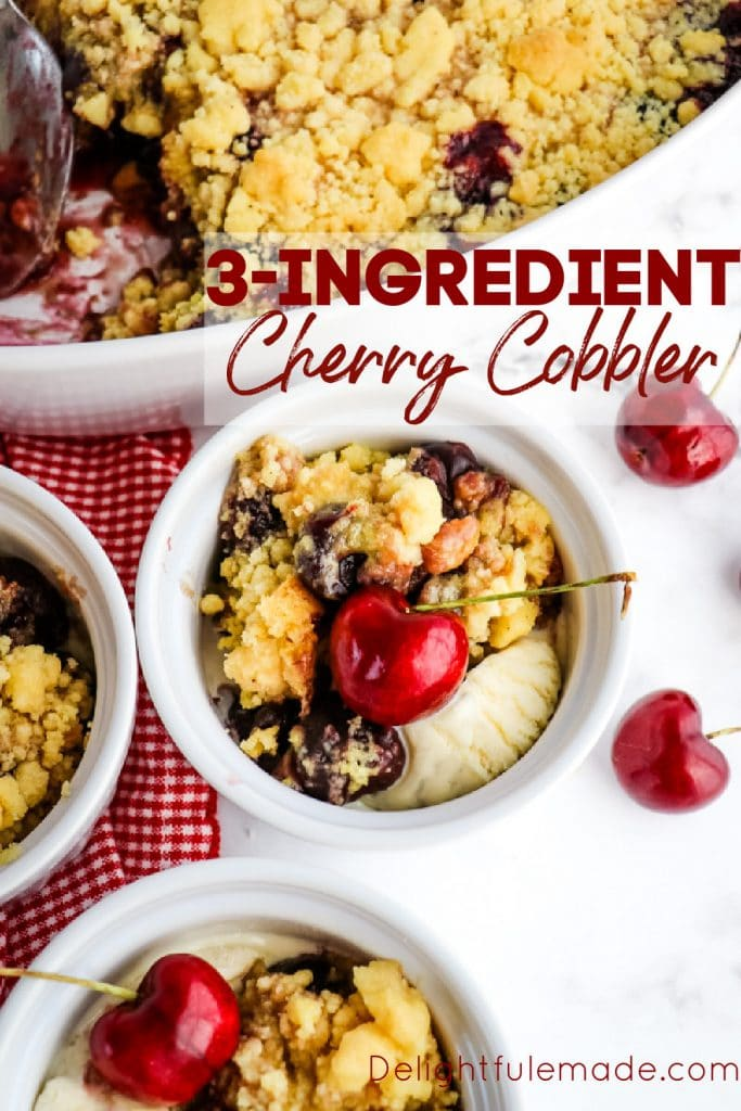 Single serving of cake mix cherry cobbler in white bowl with cherry on top.