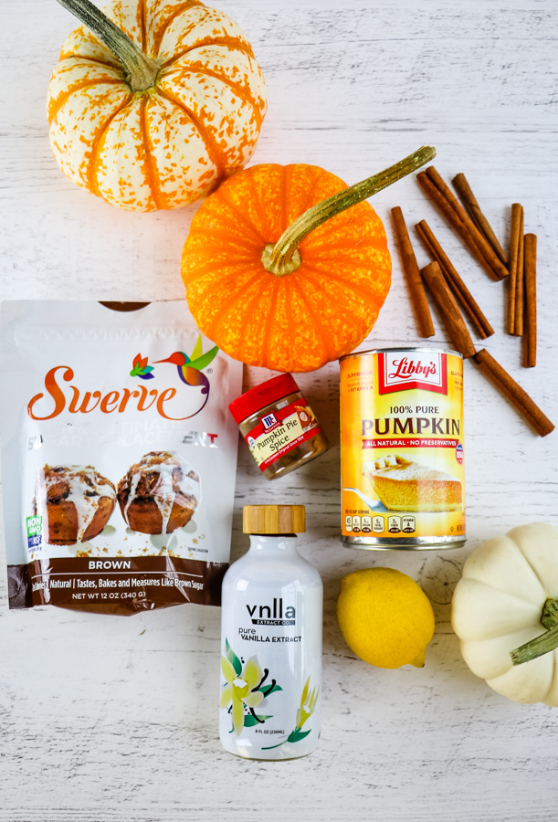 ingredients needed to make homemade pumpkin butter, along with decorative pumpkins.