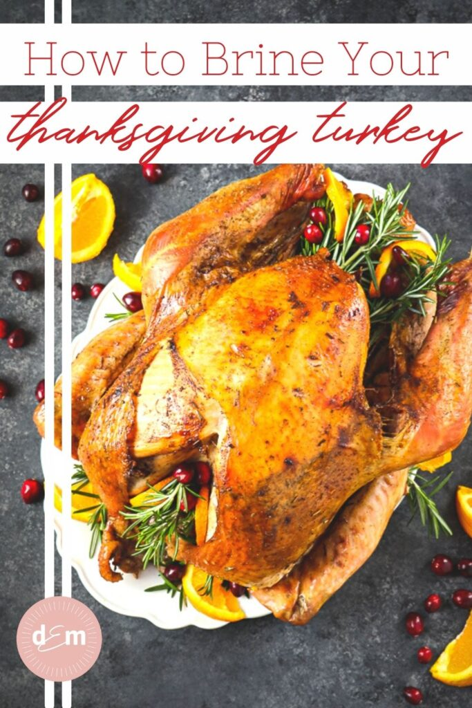 Thanksgiving turkey on platter, garnished with rosemary and oranges.