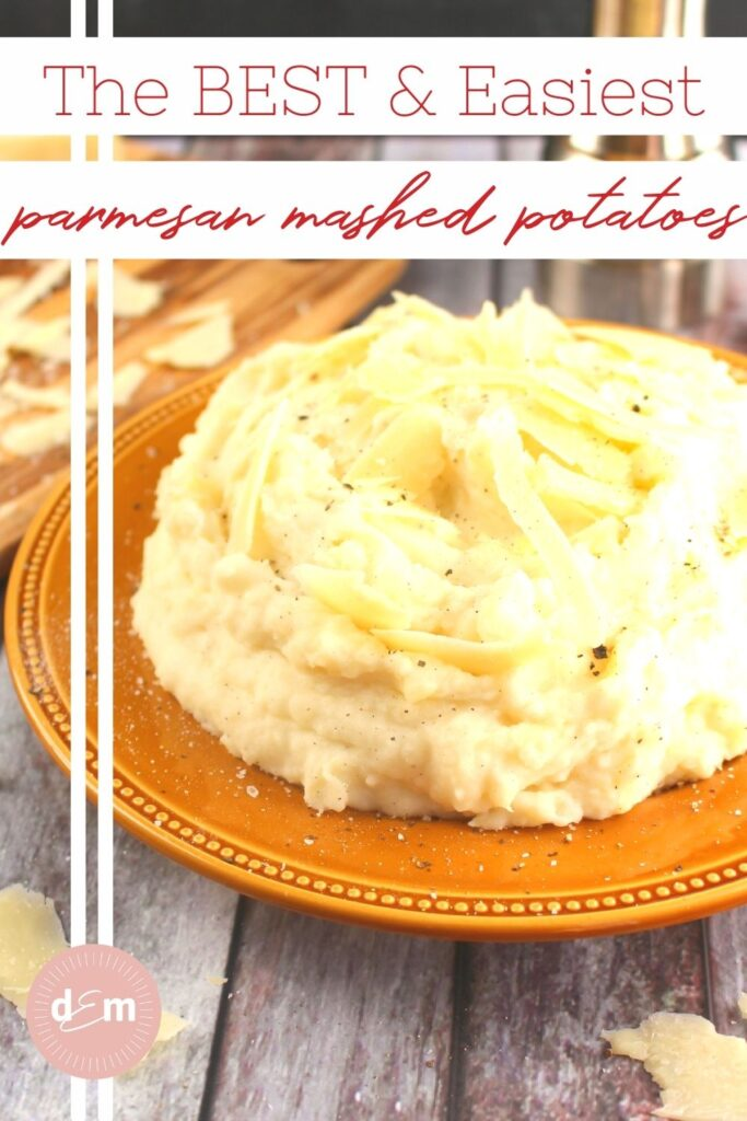Parmesan mashed potatoes on plate topped with parmesan cheese shavings.